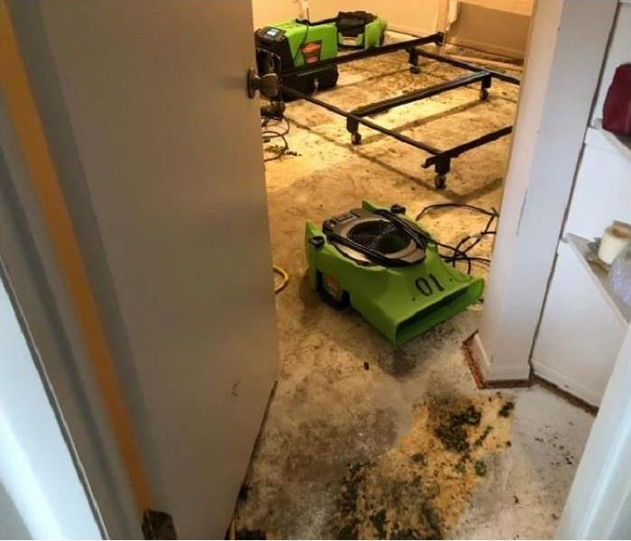 SERVPRO drying equipment in water damaged bedroom. Flooring materials have been removed.