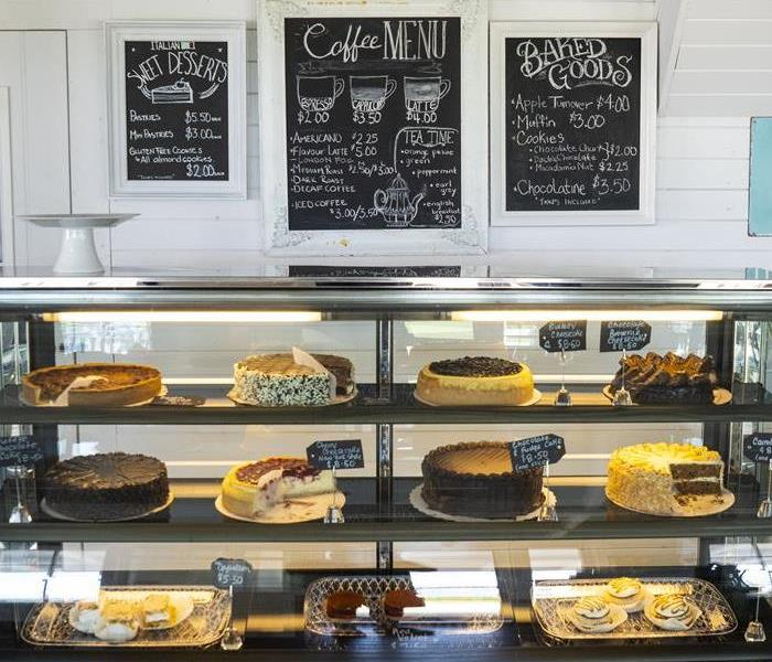 Bakery setting with cakes, pies, and sweet treats on a bakery shelves.